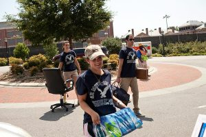 "August 20, 2011. Chapel Hill, NC.  American Eagle student ""brand ambassadors"" and volunteers helped spread awareness of the brand by helping incoming students move in and give away coupons.  Many companies have increased their efforts to reach the youth market by employing popular college students to raise the awareness of the brand by peer to peer marketing on campus' around the country."